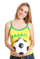 Laughing brazilian sports fan with ball
