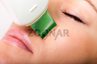 Beauty spa salon. Woman getting ultrasound skin cleaning