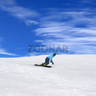Snowboarder in winter mountains