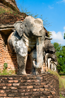 Elephants statues on ruins of Buddhist temple.