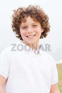 Cute handsome boy enjoys posing
