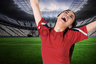 Excited asian football fan cheering