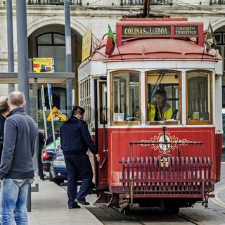 Boarding A Tram Lisbon Portugal