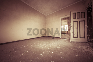 fish eye shoot of a empty dirty room with sepia color filter
