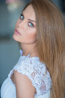 Beautiful serious young woman with blue eyes