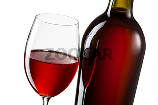 Glass of red wine and bottle isolated on white