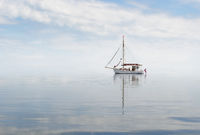 Cutter in misty sea