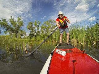 stand up paddling (SUP) on lake