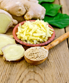 Ginger powder and grated with root and leaves on board