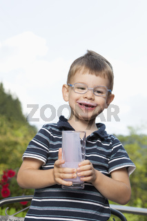 Little boy enjoying his drink