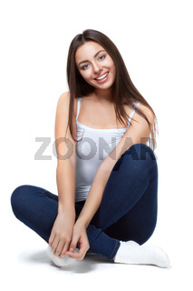 beautiful girl sitting on a white background isolated