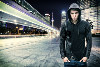 Gorgeous Youn Man in Hooded Shirt at the City Street
