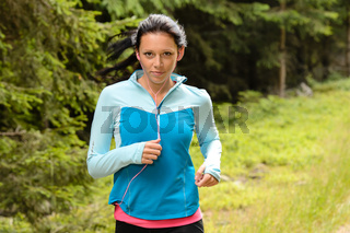 Running woman in forest  fitness training