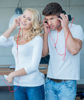 Young Couples on White Blue Attire Listening Music