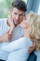 Close up Sweet Caucasian Couple in White