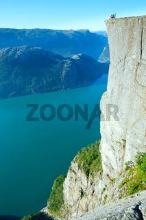 Happy family on  Preikestolen massive cliff top (Norway)