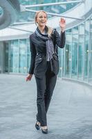 Happy Office Woman Walking Outside the Building
