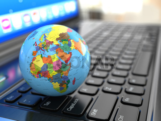 Global communications. Earth on laptop ceyboard.
