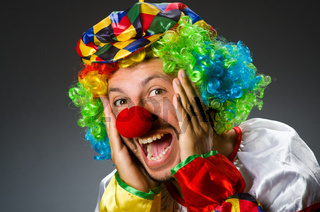 Funny clown in colourful costume