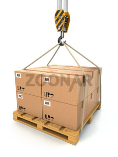 Cargo delivery. Pallet with cardboards lifted by crane.