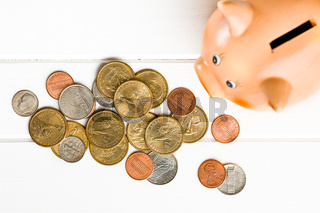 U.S. coins and piggy bank