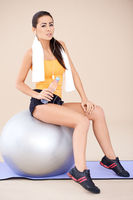 Pretty Fit Woman on Exercise Ball After Workout