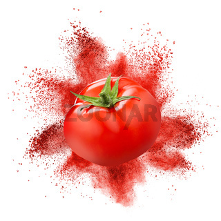 Tomato with red powder explosion isolated on white