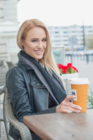Attractive woman sitting drinking coffee