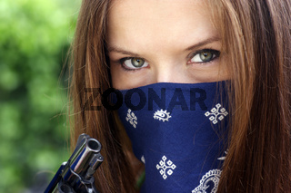 Gun Bandit Woman in Bandanna Holds Black Revolver