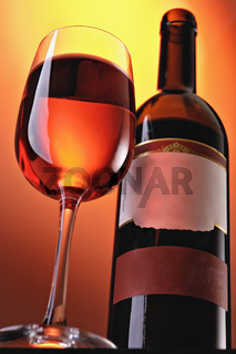 Wine in glasses and a bottle on colour a gradient a background