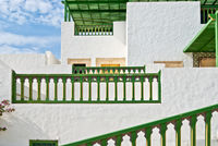 Picturesque-whitewashed-tunisian-building-with-terraces-in-traditional-style