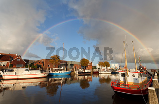 rainbow over harbor in Zoutkamp