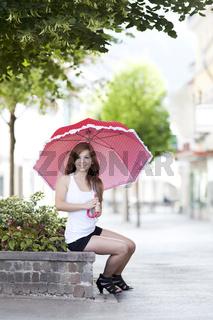 Maedchen mit Sonnenschirm