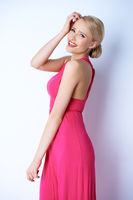 Happy Blond Young Woman in Pink Dress