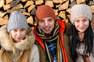 Three friends wearing winter clothes outdoor
