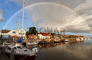 rainbow over harbor in Zoutkamp, Groningen