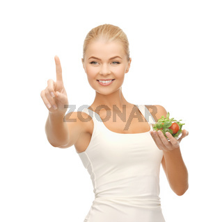 healthy woman holding bowl with salad