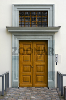 White wall and new yellow wooden door