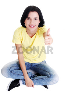 Woman sitting on floor and gesturing OK