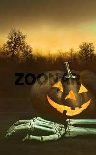 Pumpkin with skeleton hand