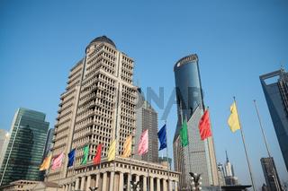 shanghai lujiazui finance and trade zone against a blue sky