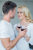 Loving couple enjoying a romantic glass of wine