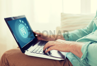 close up of man working with laptop at home