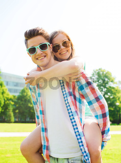 smiling couple having fun in park