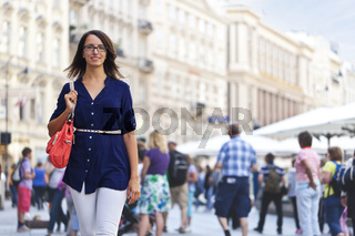 Cheerful urban girl at a city street