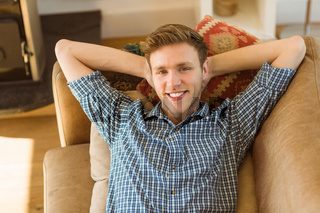 Young man relaxing on his couch