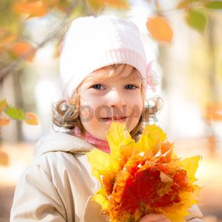 Child in autumn park
