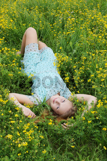 young woman in a flower meadow