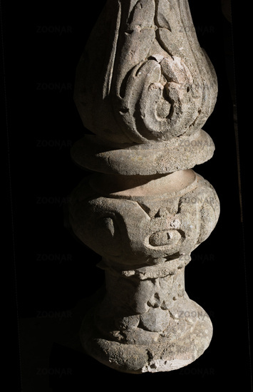 Decorated stone pillar
