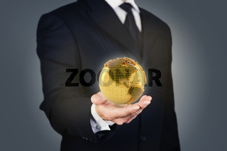 Businessman holding a golden globe